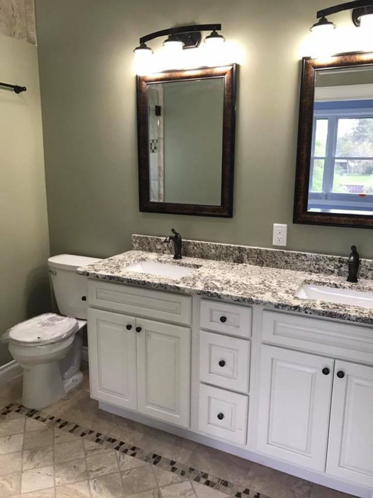 Here is a new built homes bathroom. The setting of the sinks, toilets and faucets are considered finish plumbing.